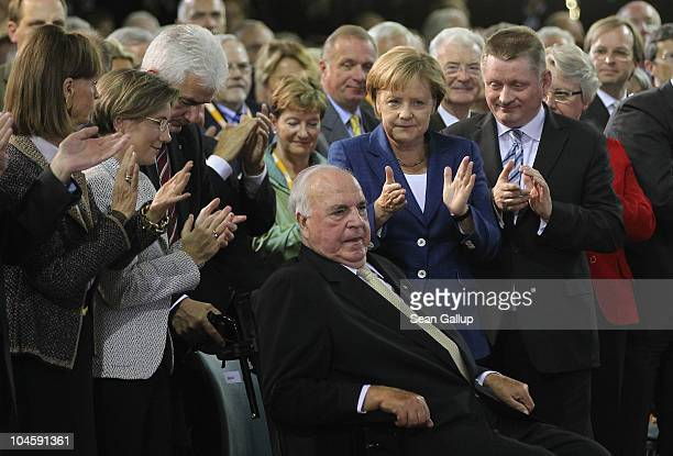 Former German Chancellor Helmut Kohl whose initiatives made German reunification in 1990 possible receives applause after speaking from his wife...