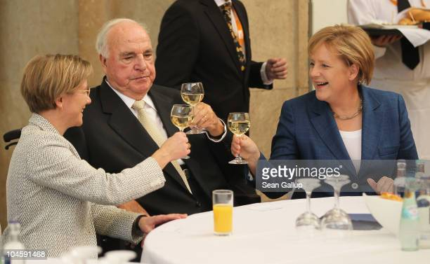 Former German Chancellor Helmut Kohl whose initiatives made German reunification in 1990 possible his wife Maike KohlRichter and current German...