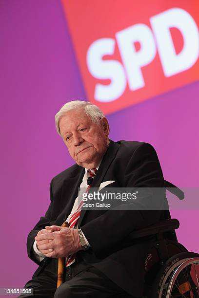 Former German Chancellor Helmut Schmidt arrives to speak at the annual federal congress of the German Social Democrats on December 4 2011 in Berlin...