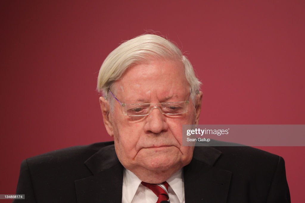 Former German Chancellor Helmut Schmidt arrives to speak at the annual federal congress of the German Social Democrats (SPD) on December 4, 2011 in Berlin, ... - former-german-chancellor-helmut-schmidt-arrives-to-speak-at-the-of-picture-id134858174