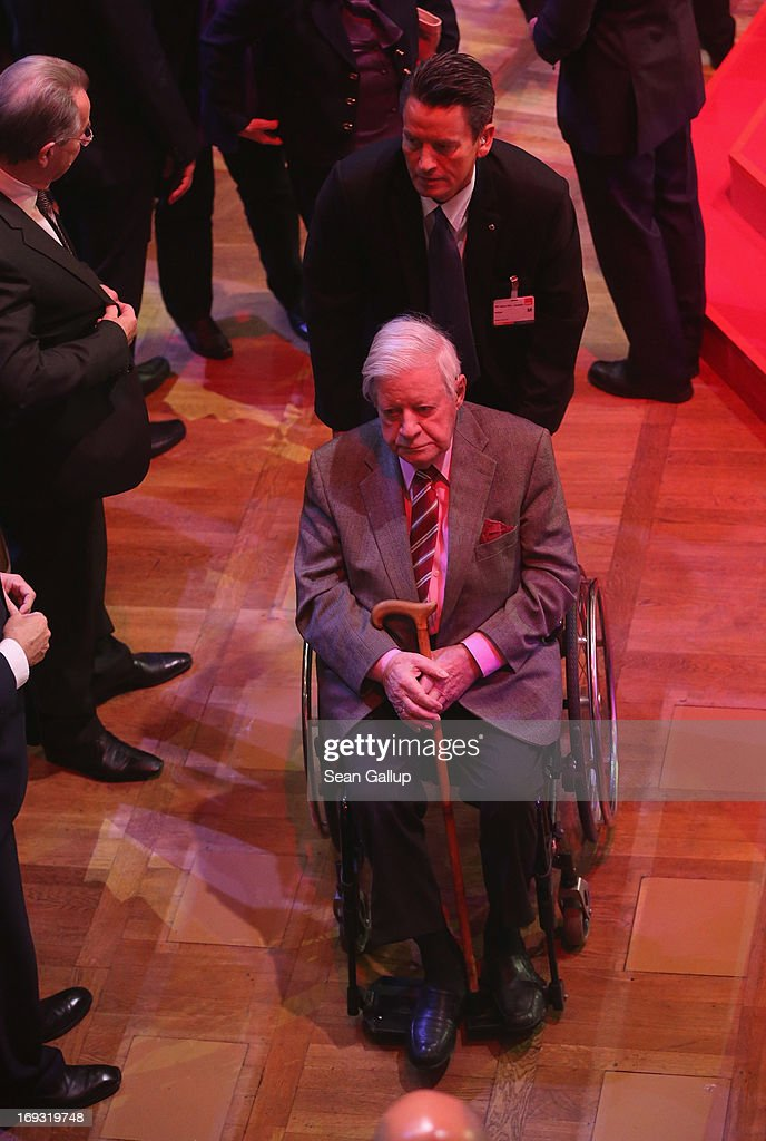 Former German Chancellor Helmut Schmidt departs after attending the 150th anniversary celebration of the German Social Democrats (SPD) on May 23, 2013 in Leipzig, Germany. The SPD, Germany's main left-wing party, traces its history to the founding of the 'Allgemeine Deutsche Arbeiterverein' (General German Workers' Association) in Leipzig in May of 1863.