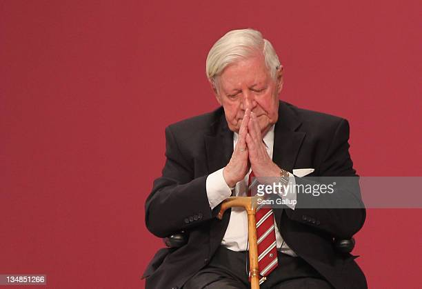 Former German Chancellor Helmut Schmidt gestures to applause from supporters after speaking at the annual federal congress of the German Social...