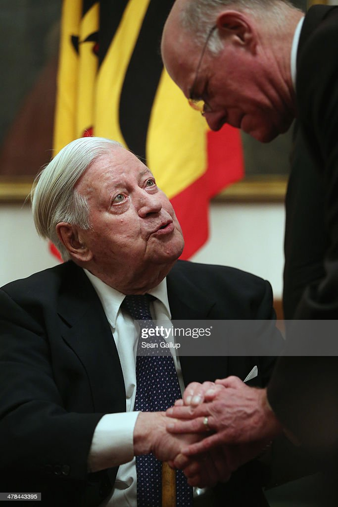 Former German Chancellor <a gi-track='captionPersonalityLinkClicked' href=/galleries/search?phrase=Helmut+Schmidt&family=editorial&specificpeople=213090 ng-click='$event.stopPropagation()'>Helmut Schmidt</a> (in wheelchair) greets Bundestag President <a gi-track='captionPersonalityLinkClicked' href=/galleries/search?phrase=Norbert+Lammert&family=editorial&specificpeople=575522 ng-click='$event.stopPropagation()'>Norbert Lammert</a> at a dinner reception on the occasion of Schmidt's 95th birthday at Schloss Bellevue on March 13, 2014 in Berlin, Germany. Schmidt was chancellor from 1974 to 1982.