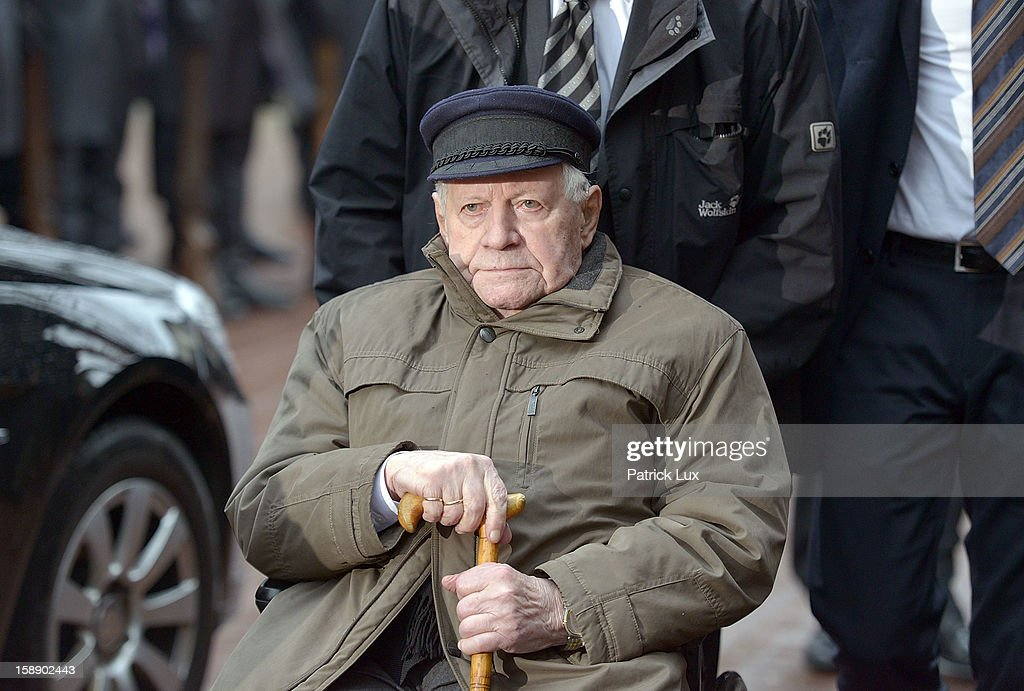 Former German Chancellor <a gi-track='captionPersonalityLinkClicked' href=/galleries/search?phrase=Helmut+Schmidt&family=editorial&specificpeople=213090 ng-click='$event.stopPropagation()'>Helmut Schmidt</a> (SPD) leaves after a memorial service for former German Defence Minister Peter Struck on January 3, 2013 in Uelzen, Germany. Struck was a leading member of the German Social Democrats (SPD) and died in December following a heart attack.