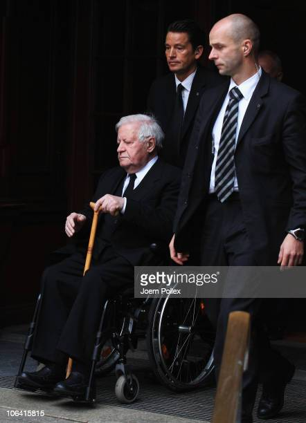 Former German Chancellor Helmut Schmidt leaves the funeral of his wife Hannelore 'Loki' Schmidt at the St Michaelis church on November 1 2010 in...