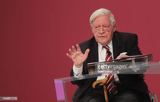 Former German Chancellor Helmut Schmidt speaks at the annual federal congress of the German Social Democrats on December 4 2011 in Berlin Germany...