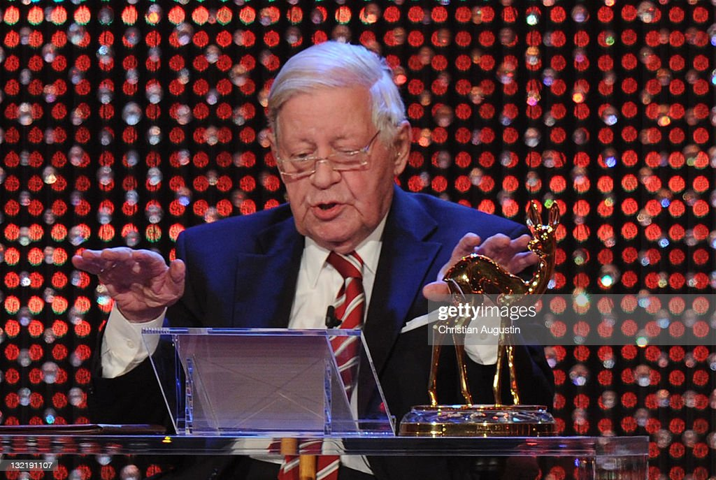 Former German Chancellor <a gi-track='captionPersonalityLinkClicked' href=/galleries/search?phrase=Helmut+Schmidt&family=editorial&specificpeople=213090 ng-click='$event.stopPropagation()'>Helmut Schmidt</a> speaks during the Bambi Award 2011 show at the Rhein-Main-Hallen on November 10, 2011 in Wiesbaden, Germany.