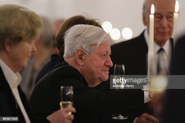 Former German chancellor Helmut Schmidt toasts with a glas of champagne during his 90th birthday dinner at Bellevue Castle on March 11 2009 in Berlin...