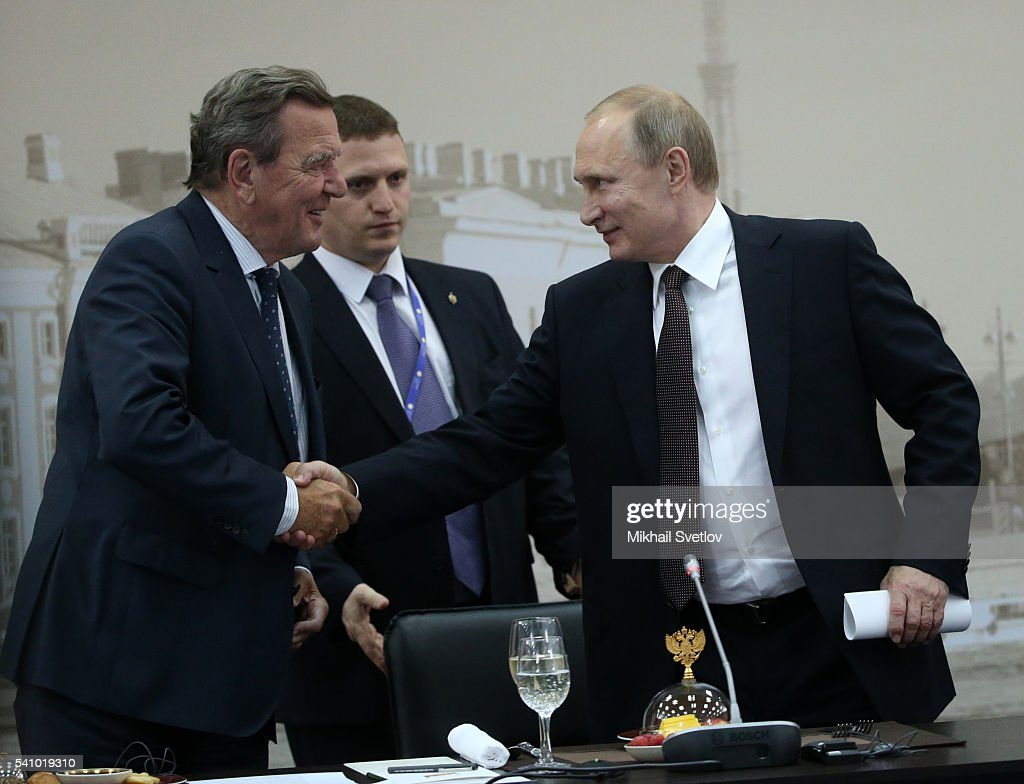 Former German Chancellor, Nord Stream Chairman of board Gerhard Schroder (L) greets Russian President Vladimir Putin (R) during the Saint Petersburg International Economic Forum SPIEF2016 on June 17, 2016 in Saint Petersburg, Russia.