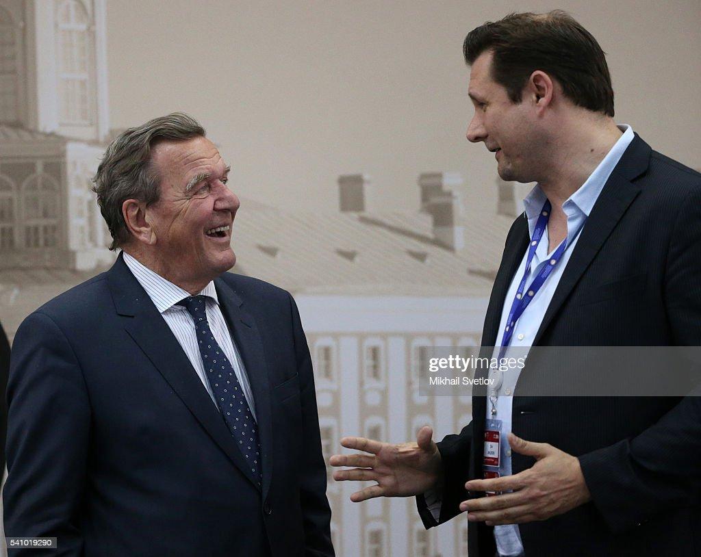 Former German Chancellor, Nord Stream Chairman of board Gerhard Schroder (L) listern to JumpStartFund Ceo Dirk Ahlborn (R) during the Saint Petersburg International Economic Forum SPIEF2016 on June 17, 2016 in Saint Petersburg, Russia.