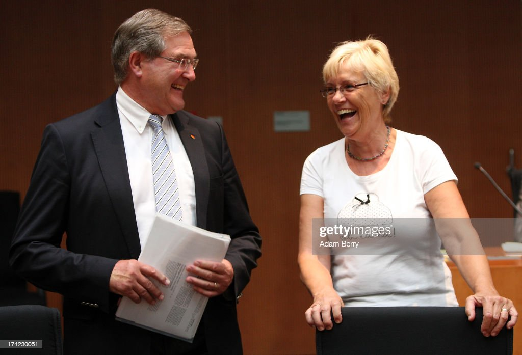 Former German Defense Minister Franz Josef Jung (L) speaks to Committee Chairwoman Susanne Kastner as he arrives for the first parliamentary inquiry witness hearing into the failed Euro Hawk drone project on July 22, 2013 in Berlin, Germany. The German government cancelled the military project, which has already consumed EUR 562 million (USD 739 million) due to complications with domestic flight certification. The parliament is expected to interview military and government officials as well as senior executives from Northrop Grumman and European Aeronautic Defence and Space Company N.V. (EADS), producers of the drones, on the matter before reporting its results in September. The affair has put pressure on German Defense Minister Thomas de Maiziere prior to elections the same month.