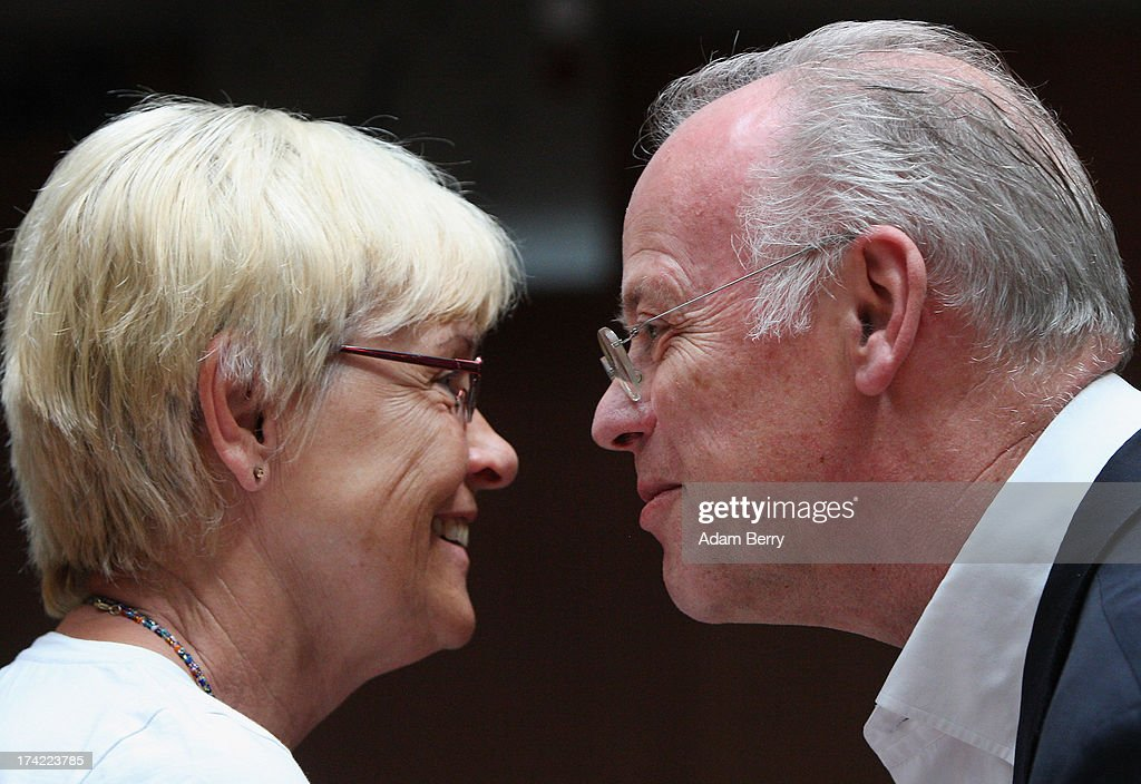 Former German Defense Minister Rudolf Scharping (R) greets Committee Chairwoman Susanne Kastner as he arrives for the first parliamentary inquiry witness hearing into the failed Euro Hawk drone project on July 22, 2013 in Berlin, Germany. The German government canceleLd the military project, which has already consumed EUR 562 million (USD 739 million) due to complications with domestic flight certification. The parliament is expected to interview military and government officials as well as senior executives from Northrop Grumman and European Aeronautic Defence and Space Company N.V. (EADS), producers of the drones, on the matter before reporting its results in September. The affair has put pressure on German Defense Minister Thomas de Maiziere prior to elections the same month.