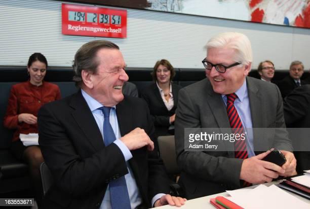 Former German Federal Chancellor Gerhard Schroeder arrives for a meeting of the German Social Democrats Bundestag faction next to SPD Bundestag...