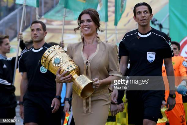 Former German figure skater Katarina Witt carries the trophy prior the DFB Cup final match between Eintracht Frankfurt and Borussia Dortmund at...
