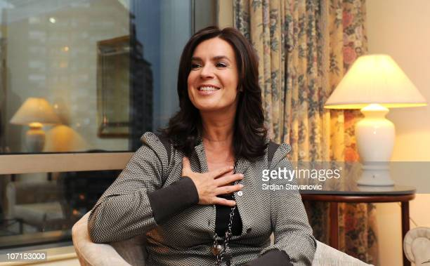 Former German figure skater Katarina Witt gestures during an interview to promote Munich as candidate city for Winter Olympics 2018 on November 25...