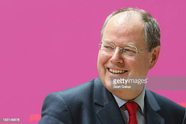 Former German Finance Minister Peer Steinbrueck speaks to the media following a meeting of the Governing Board of the German Social Democrats at SPD...