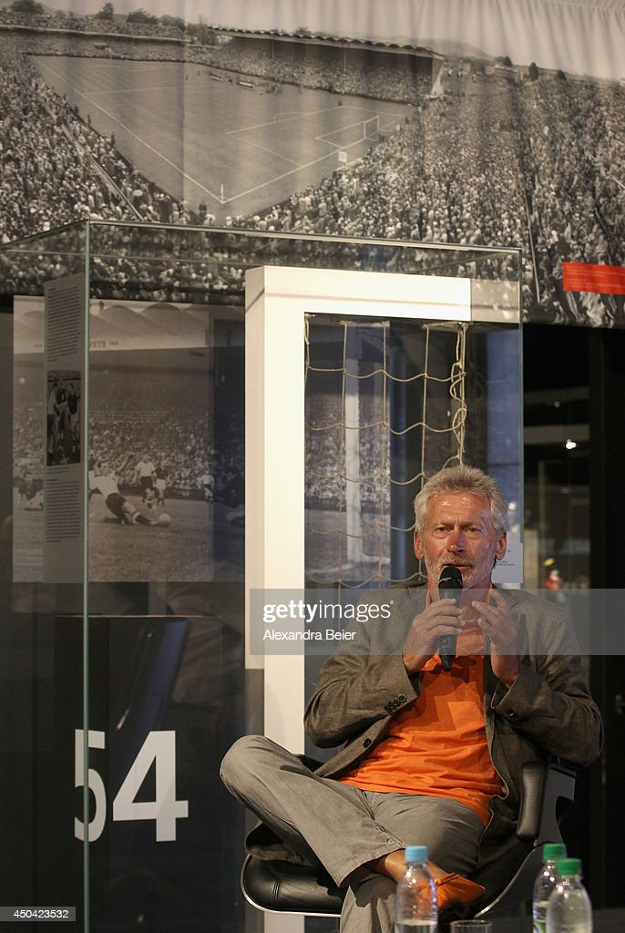 Former German football player <a gi-track='captionPersonalityLinkClicked' href=/galleries/search?phrase=Paul+Breitner&family=editorial&specificpeople=746492 ng-click='$event.stopPropagation()'>Paul Breitner</a> speaks to the audience during the opening ceremony of a World Cup 1954 exhibition at Allianz Arena Erlebniswelt museum on June 11, 2014 in Munich, Germany.