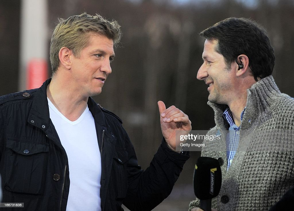 Former German national player Marco Rehmer (L) talks with head coach Franco Foda of Kaiserslautern prior to the Second Bundesliga match between Erzgebirge Aue and 1. FC Kaiserslautern at Erzgebirgs Stadium on April 15, 2013 in Aue, Germany.
