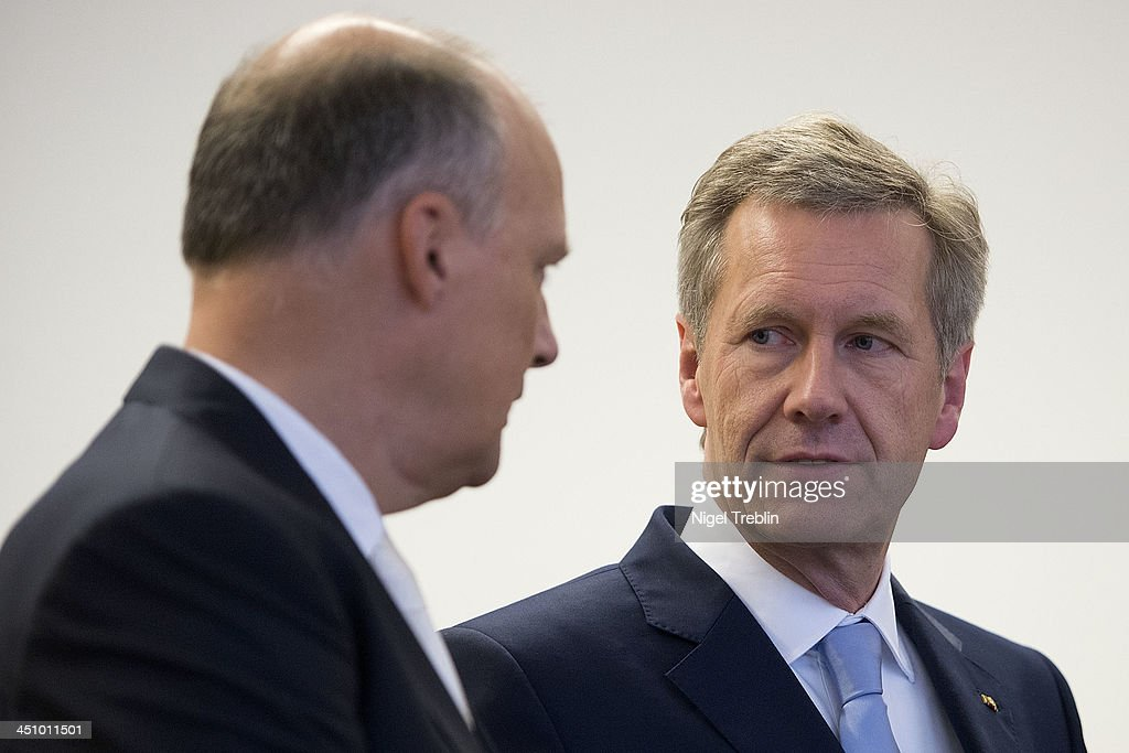 Former German President <a gi-track='captionPersonalityLinkClicked' href=/galleries/search?phrase=Christian+Wulff&family=editorial&specificpeople=221618 ng-click='$event.stopPropagation()'>Christian Wulff</a> and his advocate Michael Nagel wait in the courtroom at the Landgericht Hannover courthouse for the second day of their trial on November 21, 2013 in Hanover, Germany. Wulff is accused of accepting favors while he was governor of Lower Saxony, a charge that prompted him to resign last year from his office as president. Wulff is the first post-World War II German president to face a court trial.
