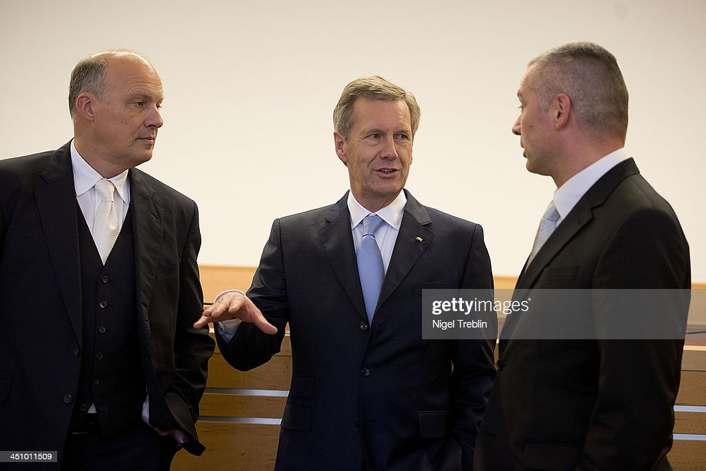 Former German President <a gi-track='captionPersonalityLinkClicked' href=/galleries/search?phrase=Christian+Wulff&family=editorial&specificpeople=221618 ng-click='$event.stopPropagation()'>Christian Wulff</a> and his advocates Michael Nagel (L) and Bernd Muessig (R) wait in the courtroom at the Landgericht Hannover courthouse for the second day of their trial on November 21, 2013 in Hanover, Germany. Wulff is accused of accepting favors while he was governor of Lower Saxony, a charge that prompted him to resign last year from his office as president. Wulff is the first post-World War II German president to face a court trial.