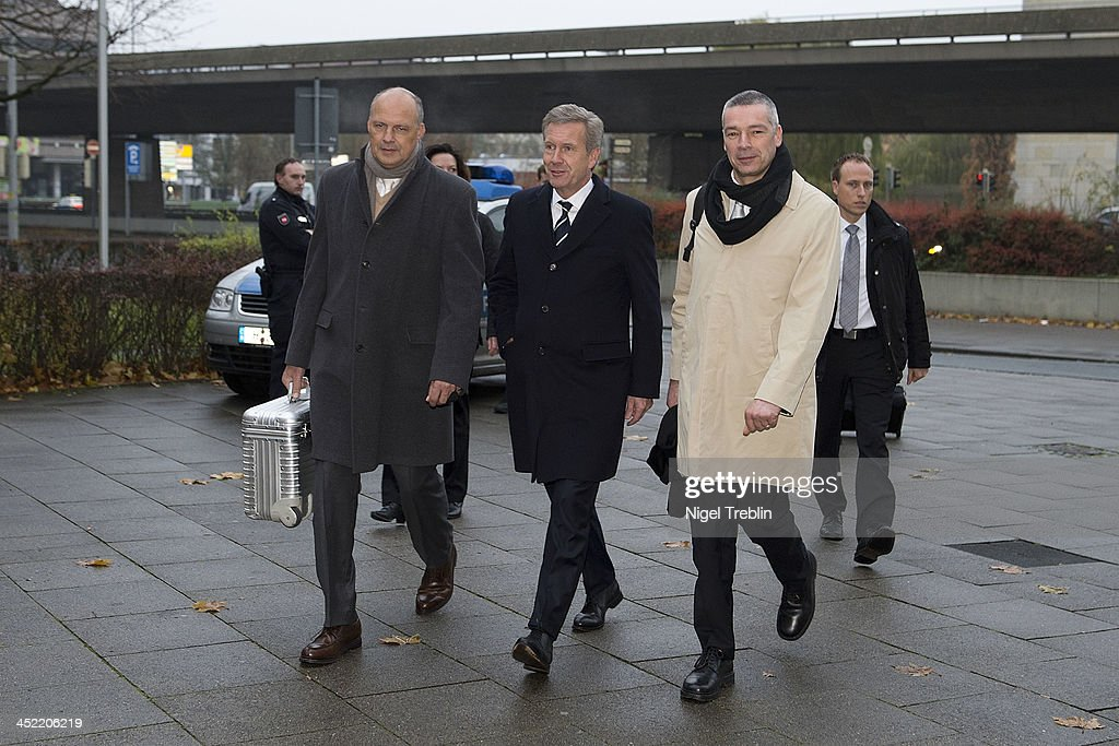 Former German President Christian Wulff and his advocates Michael Nagel (L) and Bernd Muessig (R) arrive at the Landgericht Hannover courthouse for the third day of his trial on November 27, 2013 in Hanover, Germany. Wulff is accused of accepting favors while he was governor of Lower Saxony, a charge that prompted him to resign last year from his office as president. Wulff is the first post-World War II German president to face a court trial.
