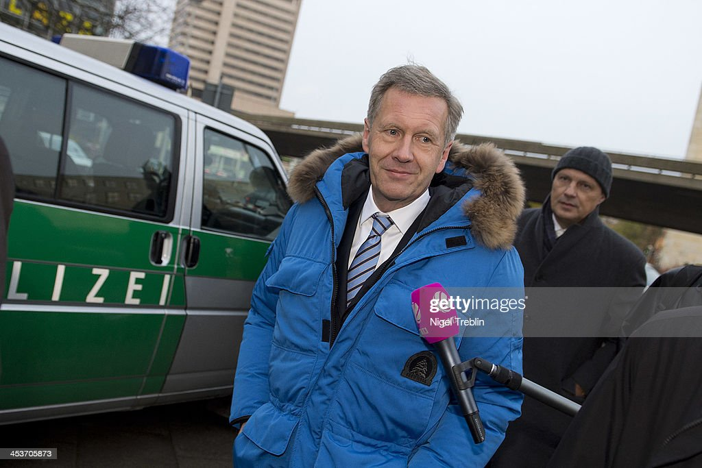 Former German President <a gi-track='captionPersonalityLinkClicked' href=/galleries/search?phrase=Christian+Wulff&family=editorial&specificpeople=221618 ng-click='$event.stopPropagation()'>Christian Wulff</a> arrives at the Landgericht Hannover courthouse for his trial on December 5, 2013 in Hanover, Germany. Wulff is accused of allowing film producer David Groenewold to pay for a Munich hotel booking while Wulff was governor of Lower Saxony in exchange for Wulff's support in promoting one of Groenewold's films. Wulff is the first post-World War II German president to face a court trial.