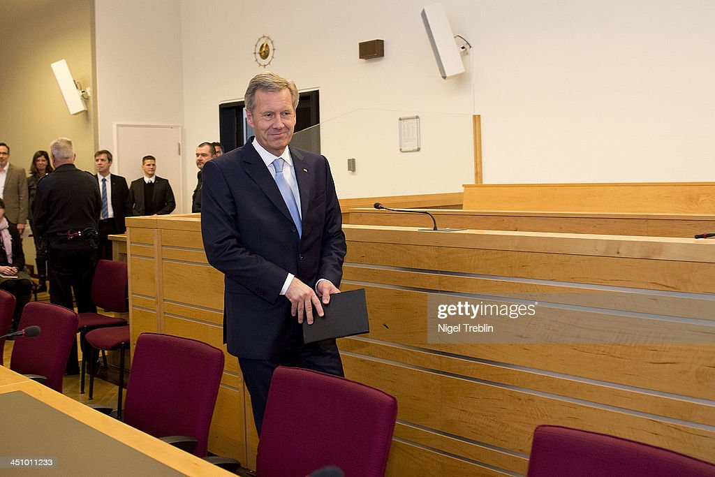 Former German President <a gi-track='captionPersonalityLinkClicked' href=/galleries/search?phrase=Christian+Wulff&family=editorial&specificpeople=221618 ng-click='$event.stopPropagation()'>Christian Wulff</a> arrives in the courtroom at the Landgericht Hannover courthouse for the second day of his trial on November 21, 2013 in Hanover, Germany. Wulff is accused of accepting favors while he was governor of Lower Saxony, a charge that prompted him to resign last year from his office as president. Wulff is the first post-World War II German president to face a court trial.