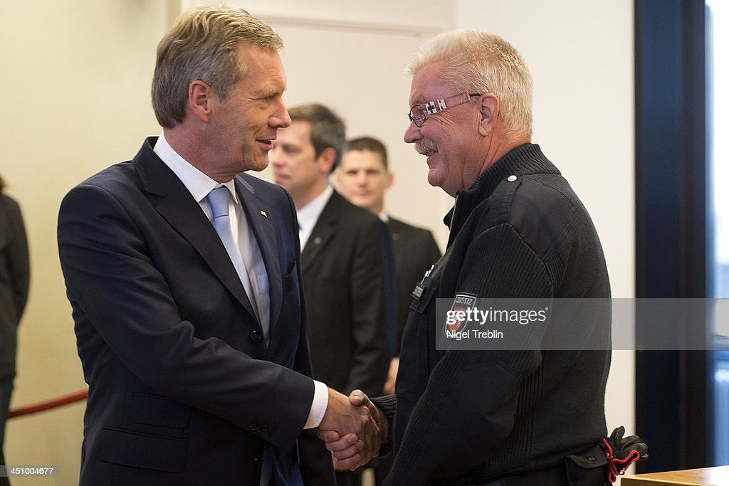Former German President <a gi-track='captionPersonalityLinkClicked' href=/galleries/search?phrase=Christian+Wulff&family=editorial&specificpeople=221618 ng-click='$event.stopPropagation()'>Christian Wulff</a> greets a judicial officer in the courtroom at the Landgericht Hannover courthouse for the second day of his trial on November 21, 2013 in Hanover, Germany. Wulff is accused of accepting favors while he was governor of Lower Saxony, a charge that prompted him to resign last year from his office as president. Wulff is the first post-World War II German president to face a court trial.