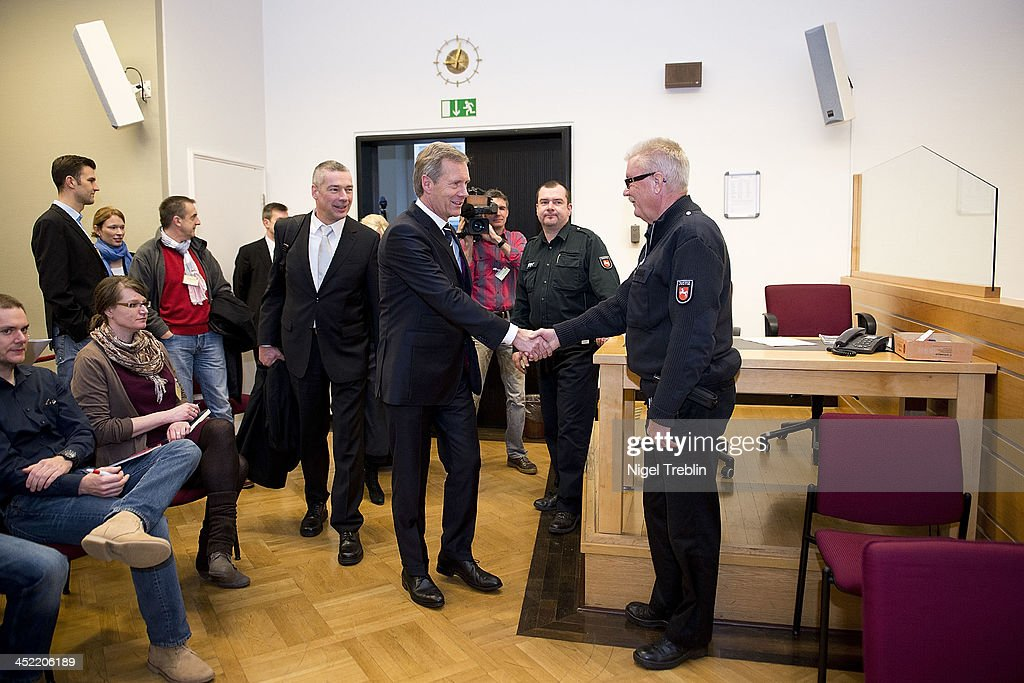 Former German President <a gi-track='captionPersonalityLinkClicked' href=/galleries/search?phrase=Christian+Wulff&family=editorial&specificpeople=221618 ng-click='$event.stopPropagation()'>Christian Wulff</a> greets a judicial officer in the courtroom at the Landgericht Hannover courthouse for the third day of his trial on November 27, 2013 in Hanover, Germany. Wulff is accused of accepting favors while he was governor of Lower Saxony, a charge that prompted him to resign last year from his office as president. Wulff is the first post-World War II German president to face a court trial.