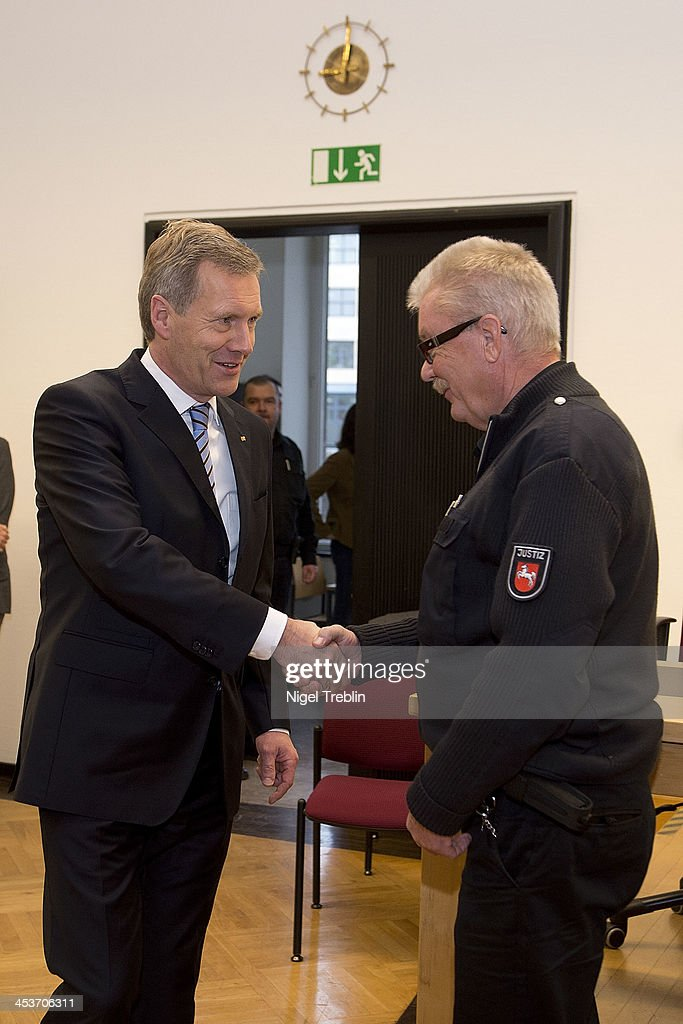 Former German President <a gi-track='captionPersonalityLinkClicked' href=/galleries/search?phrase=Christian+Wulff&family=editorial&specificpeople=221618 ng-click='$event.stopPropagation()'>Christian Wulff</a> greets a judicial officer in the courtroom at the Landgericht Hannover courthouse on December 5, 2013 in Hanover, Germany. Wulff is accused of allowing film producer David Groenewold to pay for a Munich hotel booking while Wulff was governor of Lower Saxony in exchange for Wulff's support in promoting one of Groenewold's films. Wulff is the first post-World War II German president to face a court trial.