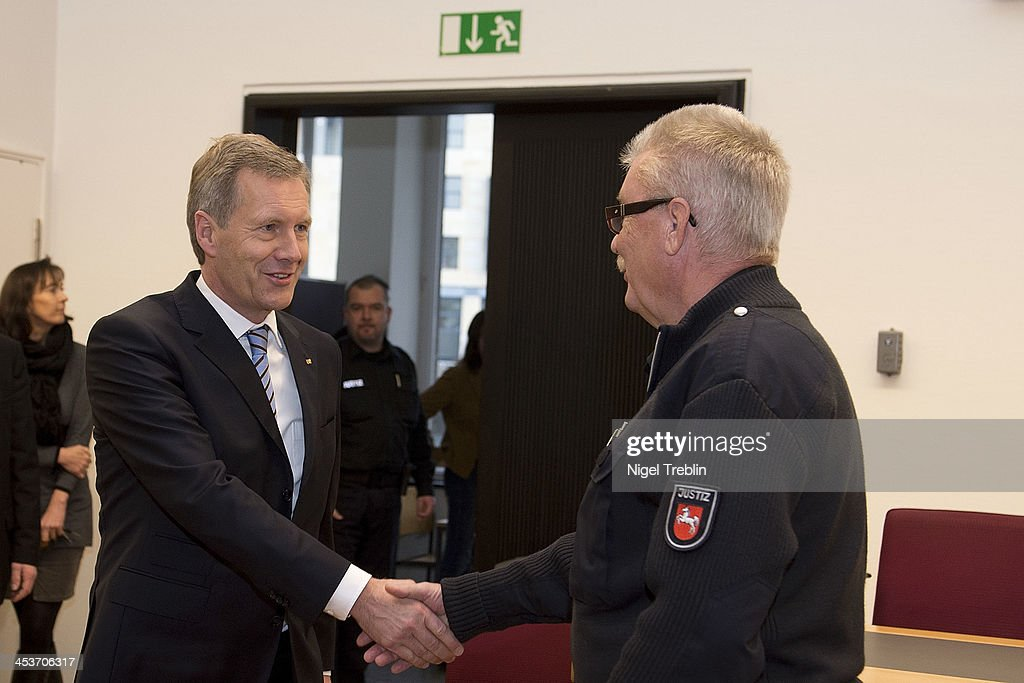 Former German President Christian Wulff greets a judicial officer in the courtroom at the Landgericht Hannover courthouse on December 5, 2013 in Hanover, Germany. Wulff is accused of allowing film producer David Groenewold to pay for a Munich hotel booking while Wulff was governor of Lower Saxony in exchange for Wulff's support in promoting one of Groenewold's films. Wulff is the first post-World War II German president to face a court trial.