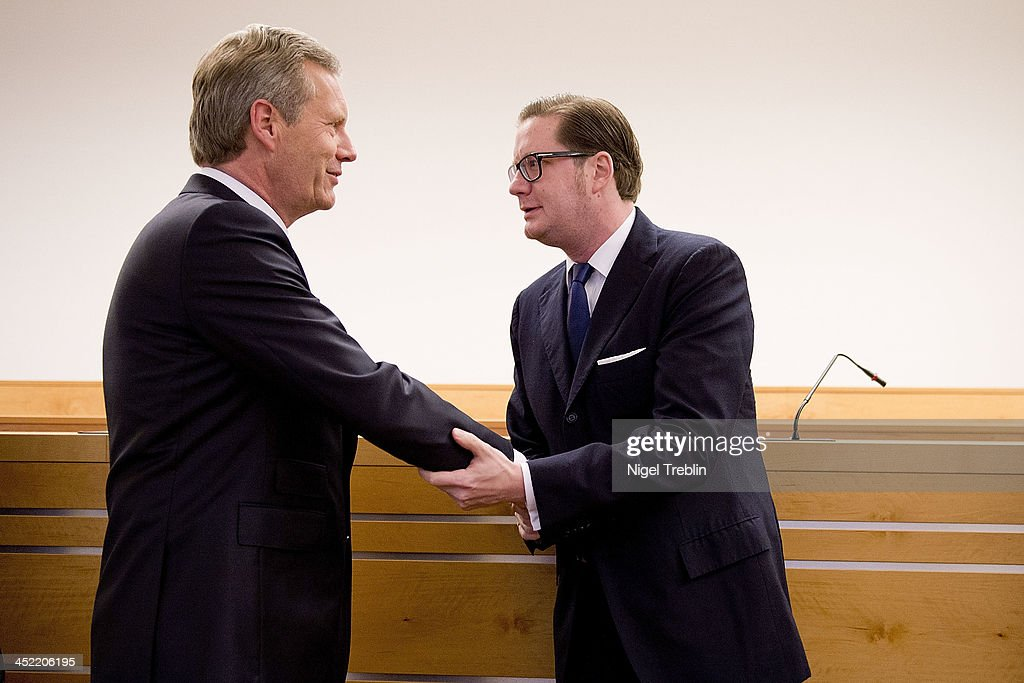 Former German President Christian Wulff greets defendant David Groenewold in the courtroom at the Landgericht Hannover courthouse for the third day of their trial on November 27, 2013 in Hanover, Germany. Wulff is accused of accepting favors while he was governor of Lower Saxony, a charge that prompted him to resign last year from his office as president. Wulff is the first post-World War II German president to face a court trial.