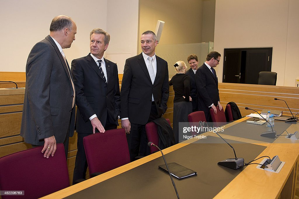 Former German President Christian Wulff (2-L), his advocates Michael Nagel (L) and Bernd Muessig and defendant David Groenewold wait in the courtroom at the Landgericht Hannover courthouse for the third day of their trial on November 27, 2013 in Hanover, Germany. Wulff is accused of accepting favors while he was governor of Lower Saxony, a charge that prompted him to resign last year from his office as president. Wulff is the first post-World War II German president to face a court trial.
