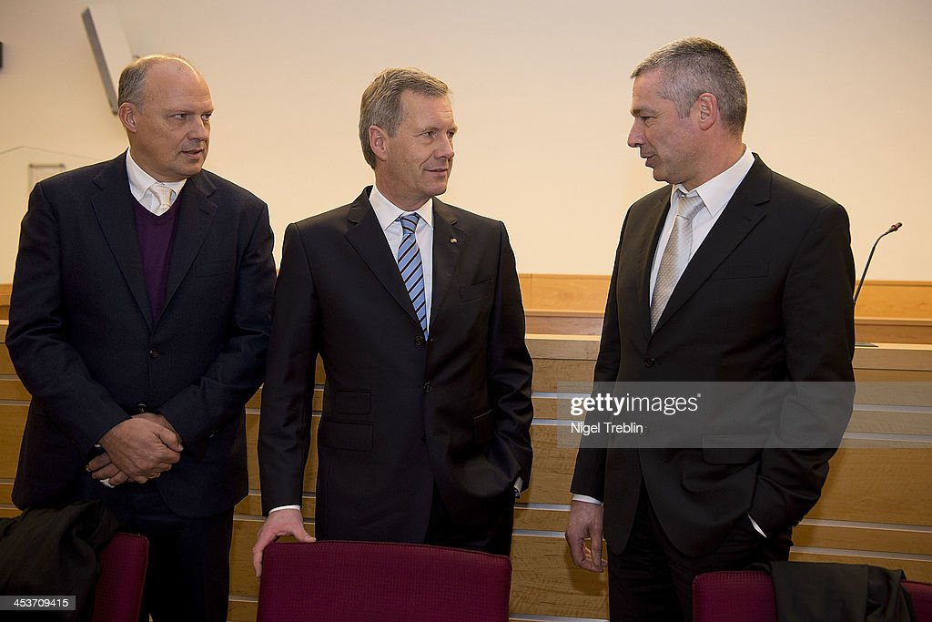 Former German President <a gi-track='captionPersonalityLinkClicked' href=/galleries/search?phrase=Christian+Wulff&family=editorial&specificpeople=221618 ng-click='$event.stopPropagation()'>Christian Wulff</a> (2-L), his advocates Michael Nagel (L) and Bernd Muessig wait in the courtroom at the Landgericht Hannover courthouse on December 5, 2013 in Hanover, Germany. Wulff is accused of allowing film producer David Groenewold to pay for a Munich hotel booking while Wulff was governor of Lower Saxony in exchange for Wulff's support in promoting one of Groenewold's films. Wulff is the first post-World War II German president to face a court trial.