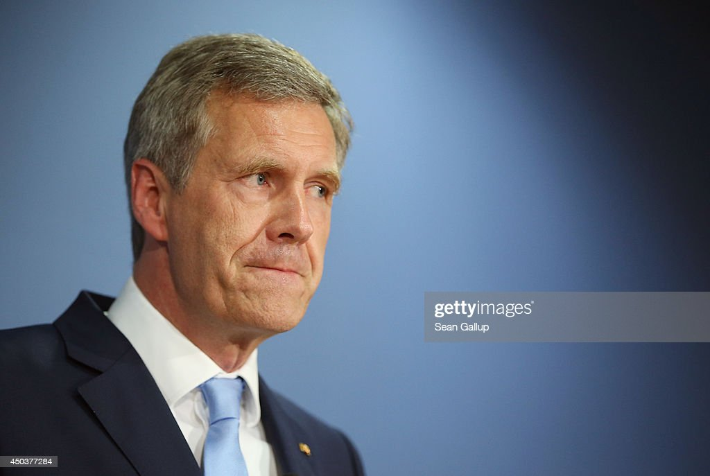Former German President <a gi-track='captionPersonalityLinkClicked' href=/galleries/search?phrase=Christian+Wulff&family=editorial&specificpeople=221618 ng-click='$event.stopPropagation()'>Christian Wulff</a> (R) presents his new book 'Ganz oben. Ganz unten.', which in English translates to 'At the top. At the bottom.' on June 10, 2014 in Berlin, Germany. The book chronicles his presidency and what he says was the extreme media pressure on him, politicians and state prosecutors that led to his resignation. Wulff resigned as president in 2012 following allegations that he had received undue favours while he was governor of Lower Saxony. A court later dropped the charges against him.