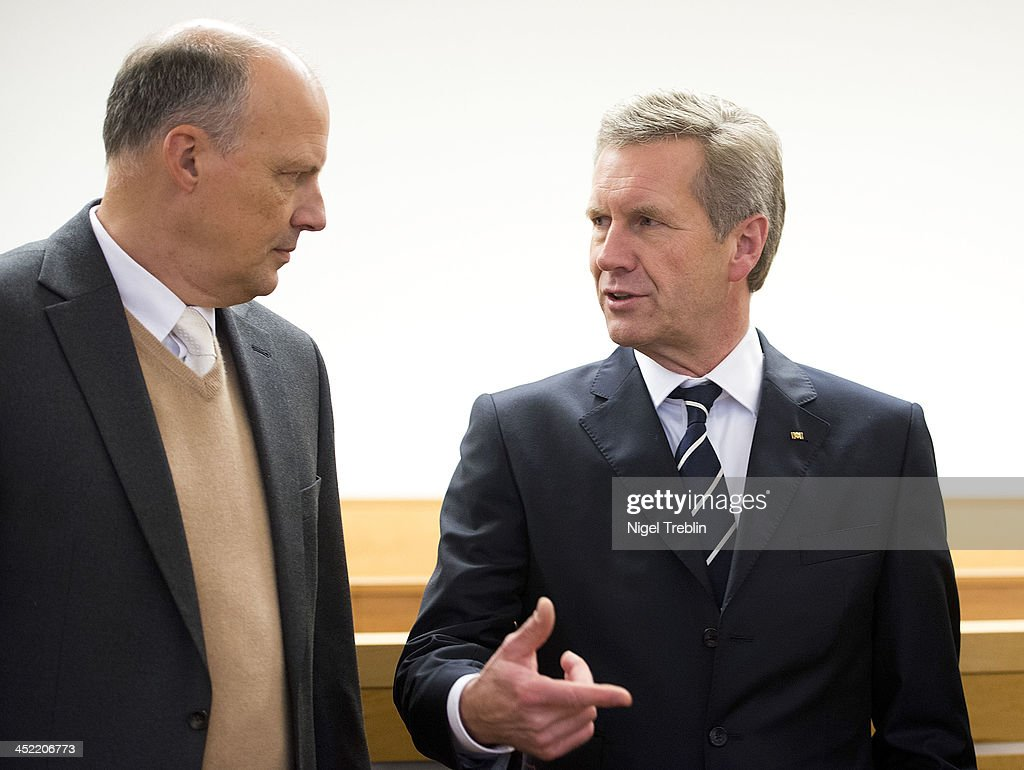 Former German President Christian Wulff speaks o his advocate Michael Nagel (L) in the courtroom at the Landgericht Hannover courthouse for the second day of his trial on November 27, 2013 in Hanover, Germany. Wulff is accused of accepting favors while he was governor of Lower Saxony, a charge that prompted him to resign last year from his office as president. Wulff is the first post-World War II German president to face a court trial.