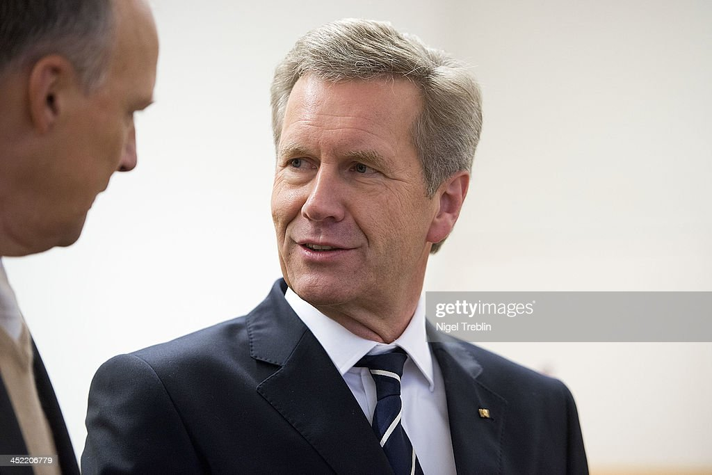 Former German President Christian Wulff speaks o his advocate Michael Nagel in the courtroom at the Landgericht Hannover courthouse for the second day of his trial on November 27, 2013 in Hanover, Germany. Wulff is accused of accepting favors while he was governor of Lower Saxony, a charge that prompted him to resign last year from his office as president. Wulff is the first post-World War II German president to face a court trial.