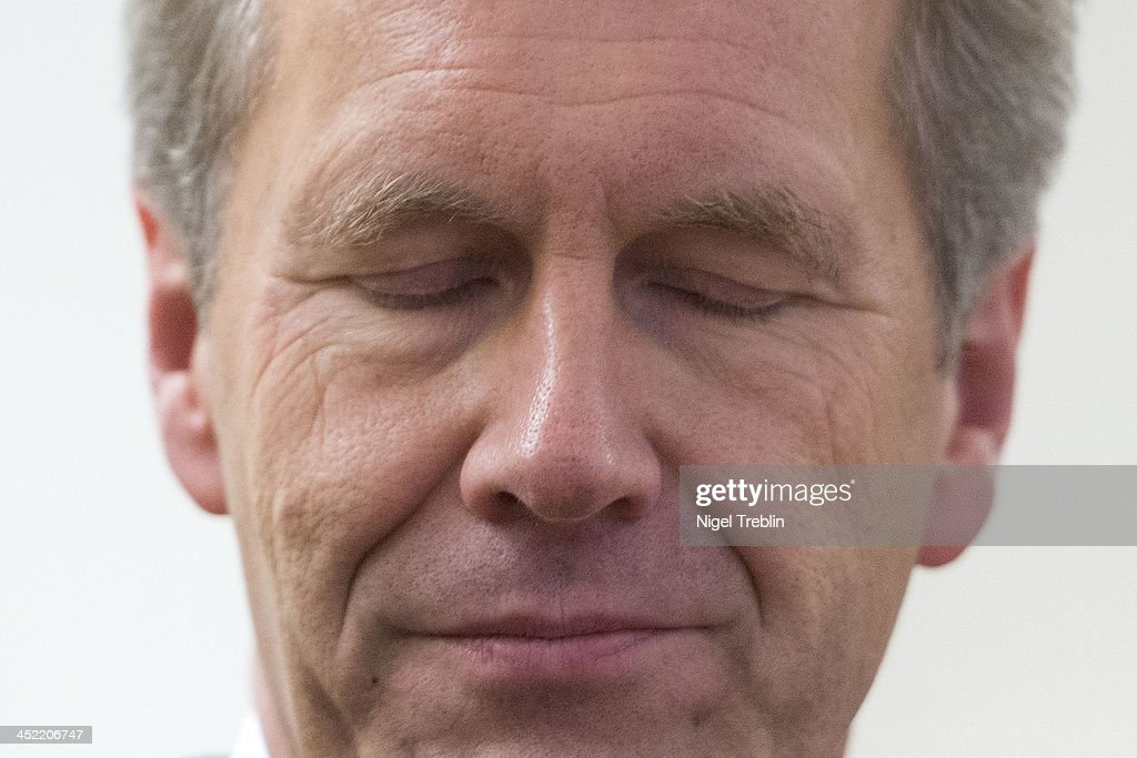 Former German President <a gi-track='captionPersonalityLinkClicked' href=/galleries/search?phrase=Christian+Wulff&family=editorial&specificpeople=221618 ng-click='$event.stopPropagation()'>Christian Wulff</a> waits in the courtroom at the Landgericht Hannover courthouse for the third day of his trial on November 27, 2013 in Hanover, Germany. Wulff is accused of accepting favors while he was governor of Lower Saxony, a charge that prompted him to resign last year from his office as president. Wulff is the first post-World War II German president to face a court trial.