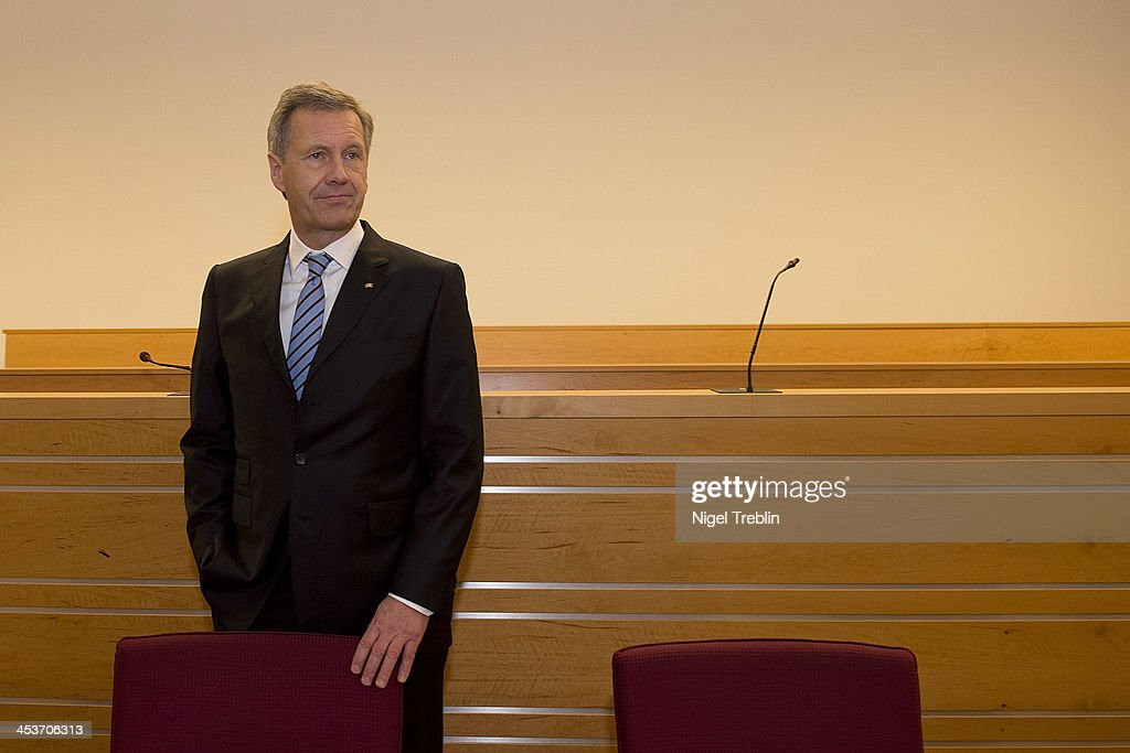 Former German President <a gi-track='captionPersonalityLinkClicked' href=/galleries/search?phrase=Christian+Wulff&family=editorial&specificpeople=221618 ng-click='$event.stopPropagation()'>Christian Wulff</a> waits in the courtroom at the Landgericht Hannover courthouse on December 5, 2013 in Hanover, Germany. Wulff is accused of allowing film producer David Groenewold to pay for a Munich hotel booking while Wulff was governor of Lower Saxony in exchange for Wulff's support in promoting one of Groenewold's films. Wulff is the first post-World War II German president to face a court trial.