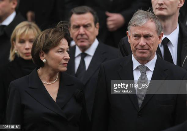 Former German President Horst Koehler and his wife Eva Luise Koehler followed behind by former German Chancellor Gerhard Schroeder and his wife Doris...