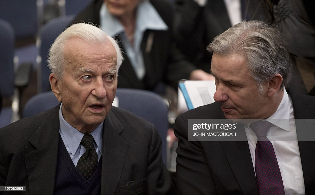 Former German president Richard von Weizsaecker (L) and Berlin Mayor Klaus Wowereit attend a ceremony during which German Chancellor Angela Merkel received the Heinz Galinski award, in Berlin on November 28, 2012. The Heinz Galinski award is given annually by the Jewish Community of Berlin to an individual or organisation who has fostered understanding in German-Jewish relations and promoted tolerance. AFP PHOTO / JOHN MACDOUGALL