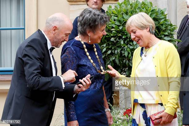 Former German skier Christian Neureuther with his wife former German skier Rosi Mittermaier and Mayor of Bayreuth Brigitte MerkErbe during the...