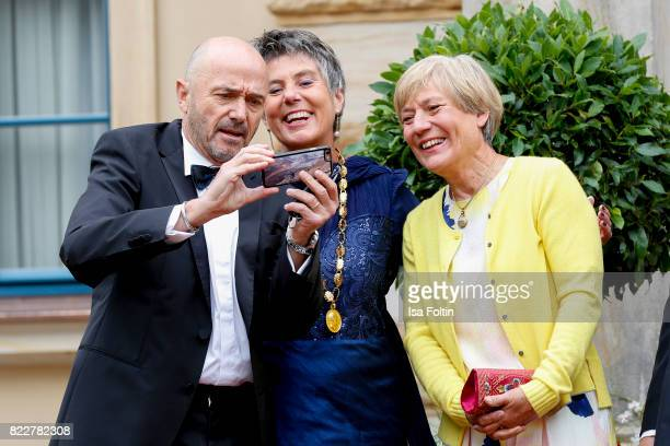 Former German skier Christian Neureuther with Mayor of Bayreuth Brigitte MerkErbe and his wife former German skier Rosi Mittermaier during the...