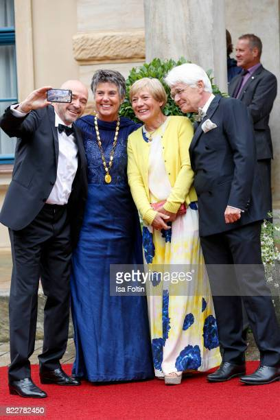 Former German skier Christian Neureuther with Mayor of Bayreuth Brigitte MerkErbe and his wife former German skier Rosi Mittermaier and Thomas Erbe...