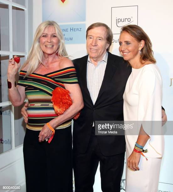 Former german soccer player Guenther Netzerr with his wife Elvira Netzer and Jonica Jahr attend the Charity Evening 'Das kleine Herz im Zentrum' at...