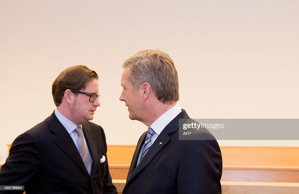 Former German President Christian Wulff (R) and co-defendant film producer David Groenewold stand in the courtroom at the regional court in Hanover, Germany, on December 5, 2013. Former President Wulff is being charged with accepting favours.