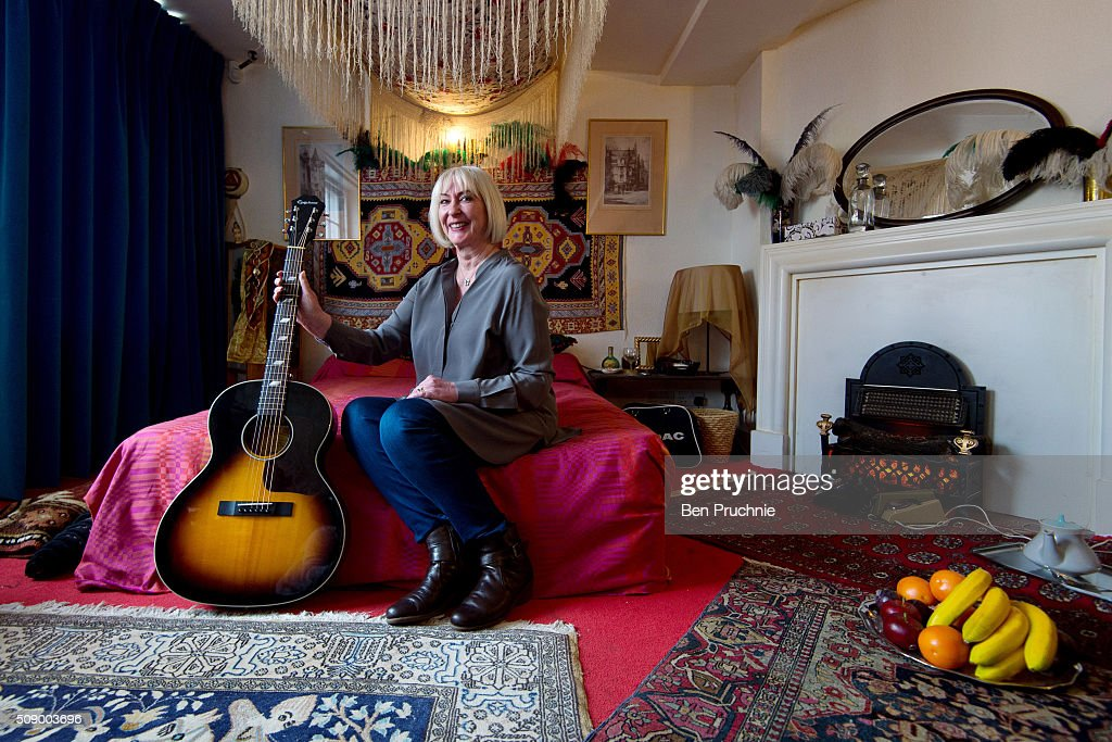 Former girlfriend of Jimi Hendrix Kathy Etchingham poses for a photograph in a recreation of his bedroom as it is displayed at the Handel and Hendrix exhibition on February 8, 2016 in London, England. The permanent exhibtion in the former London home of Jimi Hendrix celebrates the lives of Jimi Hendrix and George Frideric Handel who also lived in the property in the 1700s.