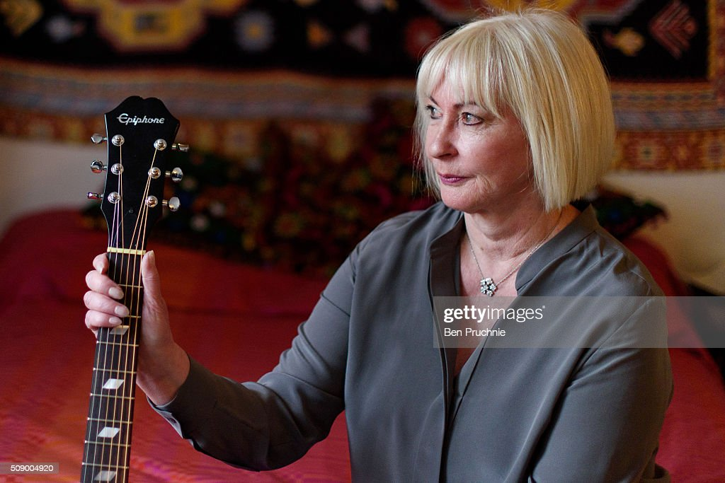 Former girlfriend of Jimi Hendrix Kathy Etchingham poses for a photograph in a recreation of his bedroom as it is displayed at the Handel and Hendrix exhibition on February 8, 2016 in London, England. The permanent exhibtion in the former London home of Jimi Hendrix celebrates the lives of Jimi Hendrix and George Frideric Handel who also lived in the property next door in the 1700s.