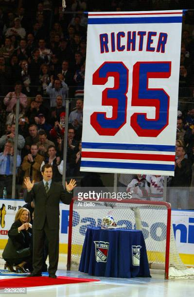 Former goalie of the New York Rangers Mike Richter waves to the crowd as his jersey banner is retired to the rafters at Madison Square Garden prior...