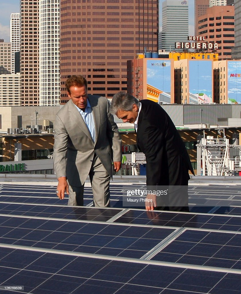 Former governor Arnold Schwarzenegger and Austrian Chancellor Werner Faymann tour Staples Center PV roof during the Solar Energy Research Labs Tour...